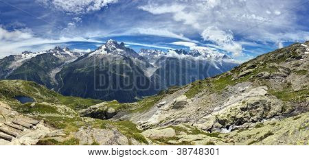 Panoramic view of blue sky and cloudscape over Mont Blanc Massif mountain range, Chamonix Valley, France.