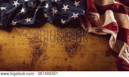 Happy Columbus Day Concept. Vintage American Flag Over Retro Treasure Manuscript.  Flat Lay, Top Vie
