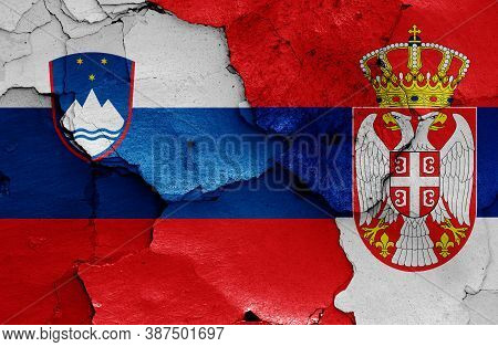 Flags Of Slovenia And Serbia Painted On Cracked Wall