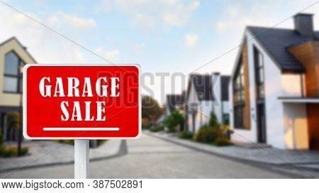 Sign With Phrase Garage Sale Near Houses In Village