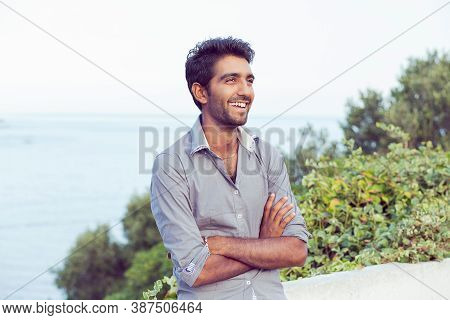 Laughing Happy Outside. Portrait Of Elegant Indian Man In Formal Gray Shirt Outdoors Smiling Happily