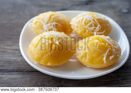 Toddy Palm Cake Is Thai Dessert In White Plate On Wooden Table.