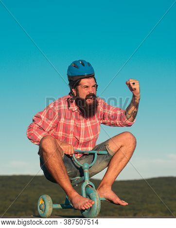 Funny Man Riding A Small Bicycle. Guy Riding Childs Tricycle