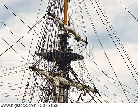 Vintage Sailing Ship Mast Ropes And Tackle, Tall Ship Rigging Mast Detail, Blue Sky Background