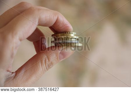 Coins In Hand. Color Toned Image. Little Money Or Small Business Concept