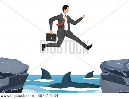 Businessman Jumping Over Shark In Water. Business Man In Suit With Briefcase Jump Between Gap. Obsta