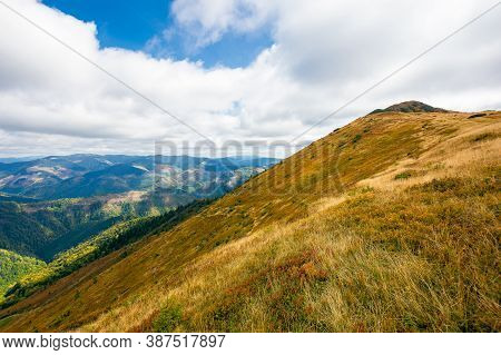 Mountain Landscape In Autumn. Dry Colorful Grass On The Hills. Ridge Behind The Distant Valley. View
