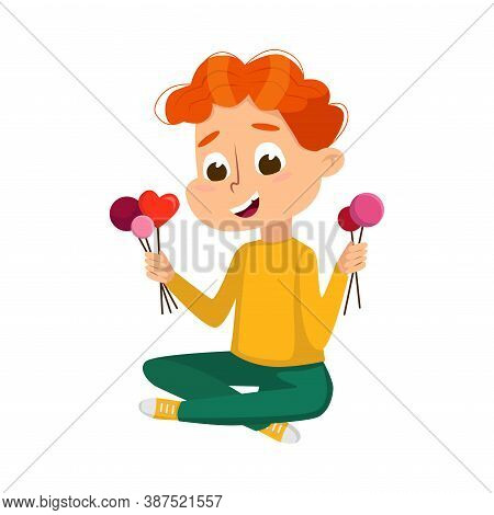 Cute Boy Eating Lot Of Sweets, Child Sitting On Floor With Lollipops In His Hands, Kid Enjoying Of E