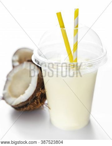 Pina Colada Alcoholic Fresh Cocktail Served Cold With Coconut And Banana On A White Background
