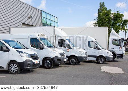 Bordeaux , Aquitaine / France - 09 25 2020 : Transport Dumont  Several Cars Vans Trucks Parked In Pa