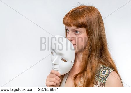 Mysterious Woman Cover Her Face Behind Anonymous White Mask