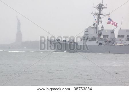 NEW YORK-OCT 9: USS Michael Murphy (DDG 112) passes near the Statue of Liberty as it departs New York Harbor in rain and fog fully commissioned into active service in New York on October 9, 2012.