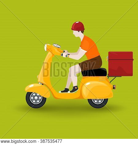 Young Guy Rides A Scooter, Orange Vintage Scooter With Box For Food Delivery Isolated On Green Backg
