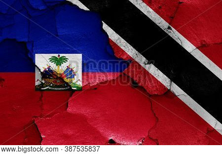 Flags Of Haiti And Trinidad And Tobago Painted On Cracked Wall