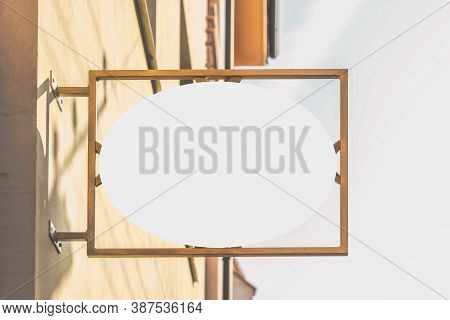 Mock Up Sign. Blank White Rounded Signage On A Building Wall