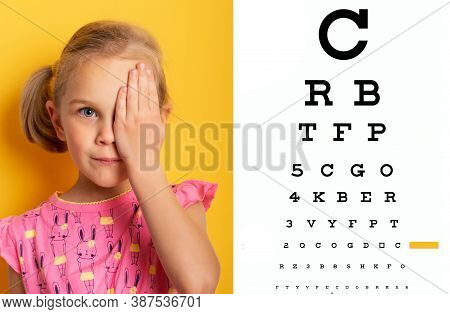 Eyesight Check. Girl Covering One Eye With Hand. Eyesight Check And Health Examinations.ophthalmolog