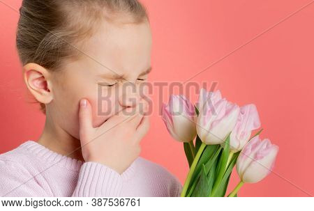 Studio Portrait Of Allergic Little Girl Having An Allergic Reaction To Flowers - Tulips, Selective F
