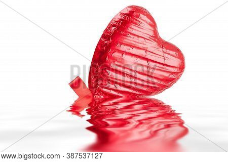 Red Chocolate Love Heart Lollypop With A Red Ribbon Bow On A Stick. Isolated On A White Background A