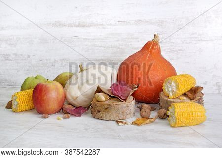 Various And Colorful Autumnal Vegetables And Fruits On White Background