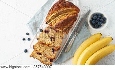 Homemade Banana Bread. Baked Cake. Top View, White Table.