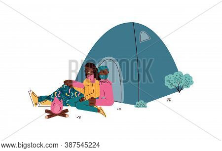 Romantic Couple Of Hikers Or Tourists, Backpackers Sitting And Resting Near Campfire At Campsite, Fl
