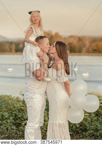 Portrait of a happy family waiting for a baby