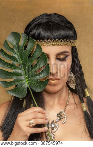Portrait of a young woman in the image of Cleopatra