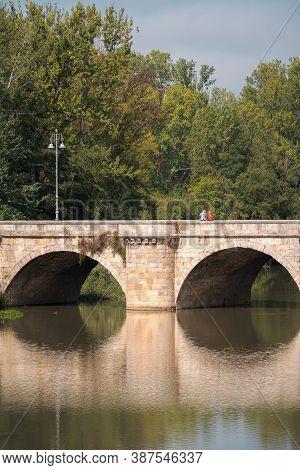 Ashlar Stone Medieval Bridge, Puente Mayor, Crossing Rio Carrion, In Autumn. Palencia, Spain.