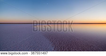 Sunset Genichesk Pink Extremely Salty Lake Panorama (colored By Microalgae With Crystalline Salt Dep