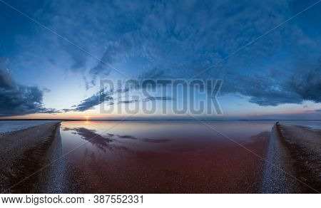 Sunset On The Genichesk Pink Extremely Salty Lake Panorama (colored By Microalgae With Crystalline S