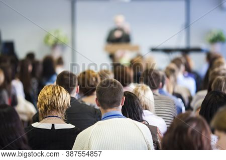 Conferences Concept. Male Lecturer Speaking In Front Of The Audience During The Conference. Horizont