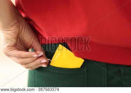 Womans Hand Holds A Wedding Ring And Condom And Hides It In Her Pocket. Adultery Reasons And Exit Fr