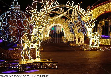 Abstract Background Of Light Tunnel With Deers And Christmas Balls With Defocused Lights