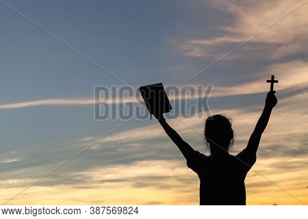 Women Standing Holding Holy  Bible For Worshipping God At Sunset Background, Pray To The God, Christ