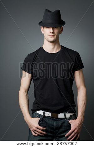 Young handsome tall guy posing in black t-shirt.
