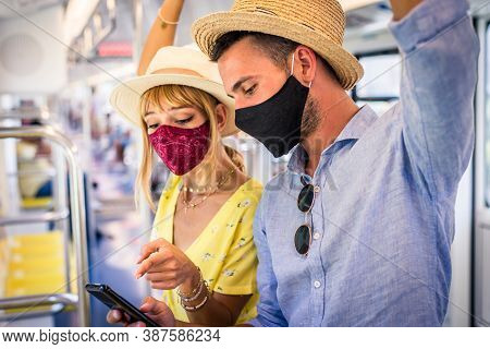 Couple Travelling In The Subway During Covid-19 Pandemic