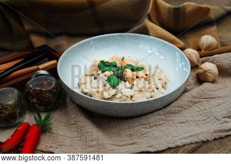 risotto with fresh cream, salted chicken, rehydrated ceps and mushrooms