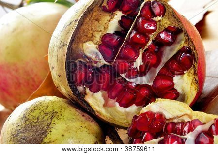 closeup of a pile of appetizing pomegranate fruits with its red arils