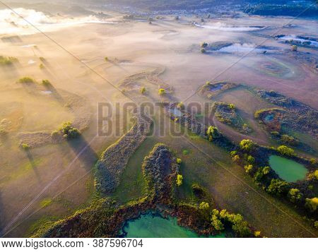 Aerial View To Valley Of Siverskyi Donets River Near Zmiiv With Lakes And Withered Grass, Calm Autum