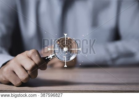 Focus In Objective Target And Goal Concept, Businessman Manager Holding Magnifier Glass With Virtual