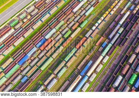 Cargo Railway Carriage. Colorful Freight Trains On The Railway Sort Facility. Wagons With Goods On R