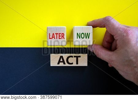 Act Now Or Later. Businessman Holds A Cubes With Word 'now'. Wooden Cubes With  Words 'act, Later'.