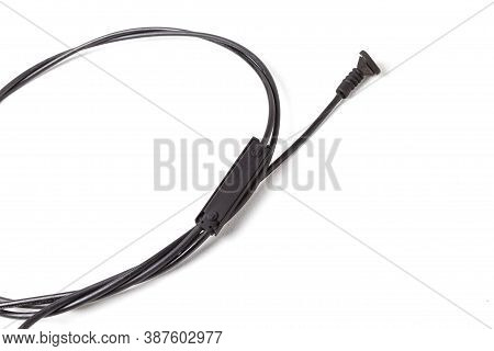 The Removed Spare Part From The Car On A White Isolated Background Is A Hood Opening Cable For Repla