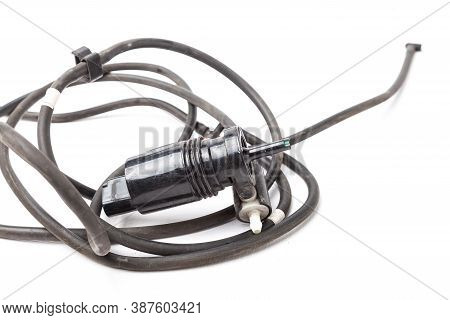 Black Plastic Glass Washer Pump Reservoir With Wire And Hose On A White Isolated Background. Used Sp