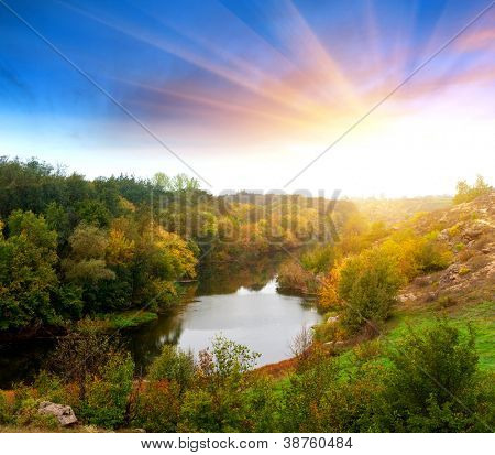 Autumn landscape with river in evening time