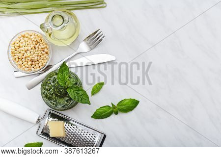 Pesto Sauce With Ingredients: Pine Nuts, Basil, Olive Oil, Parmesan, Cutlery, Raw Green Fettuccine O
