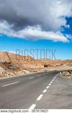 view of a no traffic road in a desert landscape in Gran Canaria, in the Canary Islands, Spain