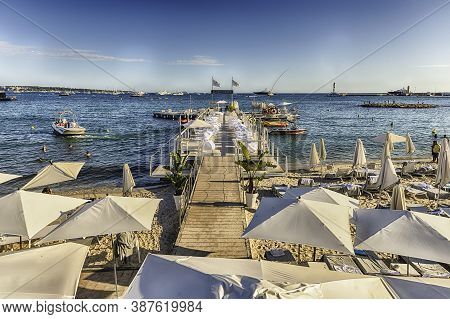Cannes, France - August 15: Setup Of The Tables And Unbrellas At The Beach Of The Majestic Barriere