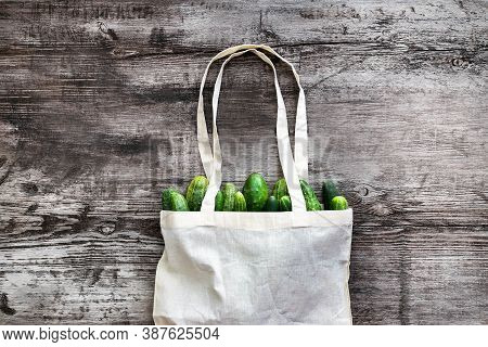 Bag Canvas Fabric White For Mockup Blank Template On Wooden Background With Vegetebles Inside: Cucum