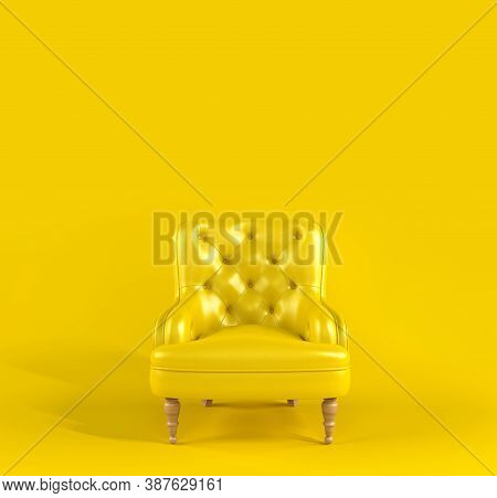 Yellow Leather Armchair With Quilted Back And Wooden Legs On Yellow Background Front View. Creative